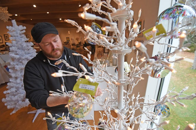 Jerry Francl, operations director at the Mansfield Art Center, works on a display for the upcoming Holiday Fair 2018. The preview party will be Friday, Nov. 16, and the 49th annual Holiday Fair will run from Saturday through Dec. 30.