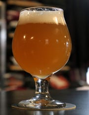 Snowglobe spiced holiday ale is a new beer at Phoenix Brewery in Mansfield.