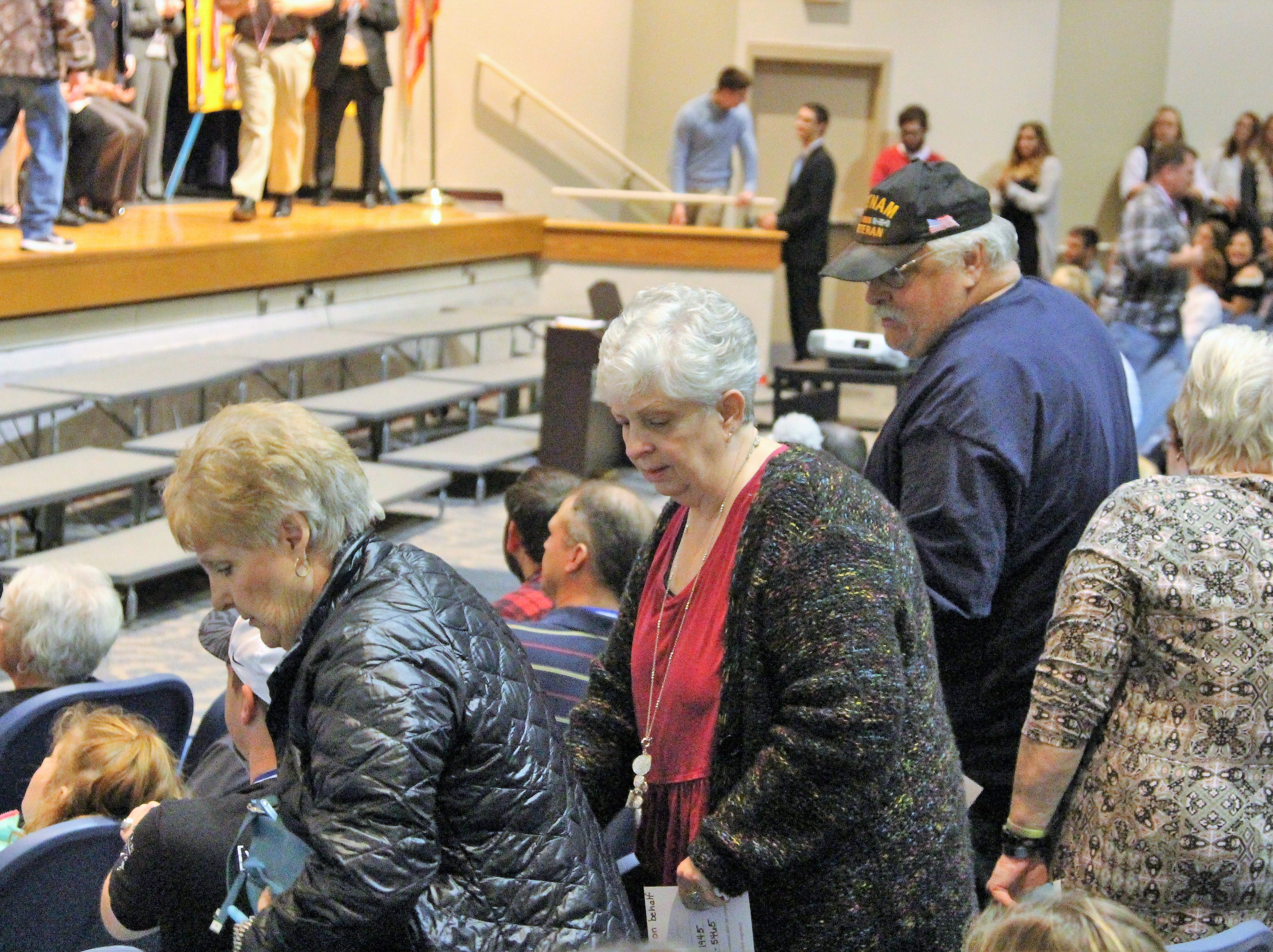 Marion veterans take their seats on Tuesday during a Veterans Celebration hosted by River Valley.