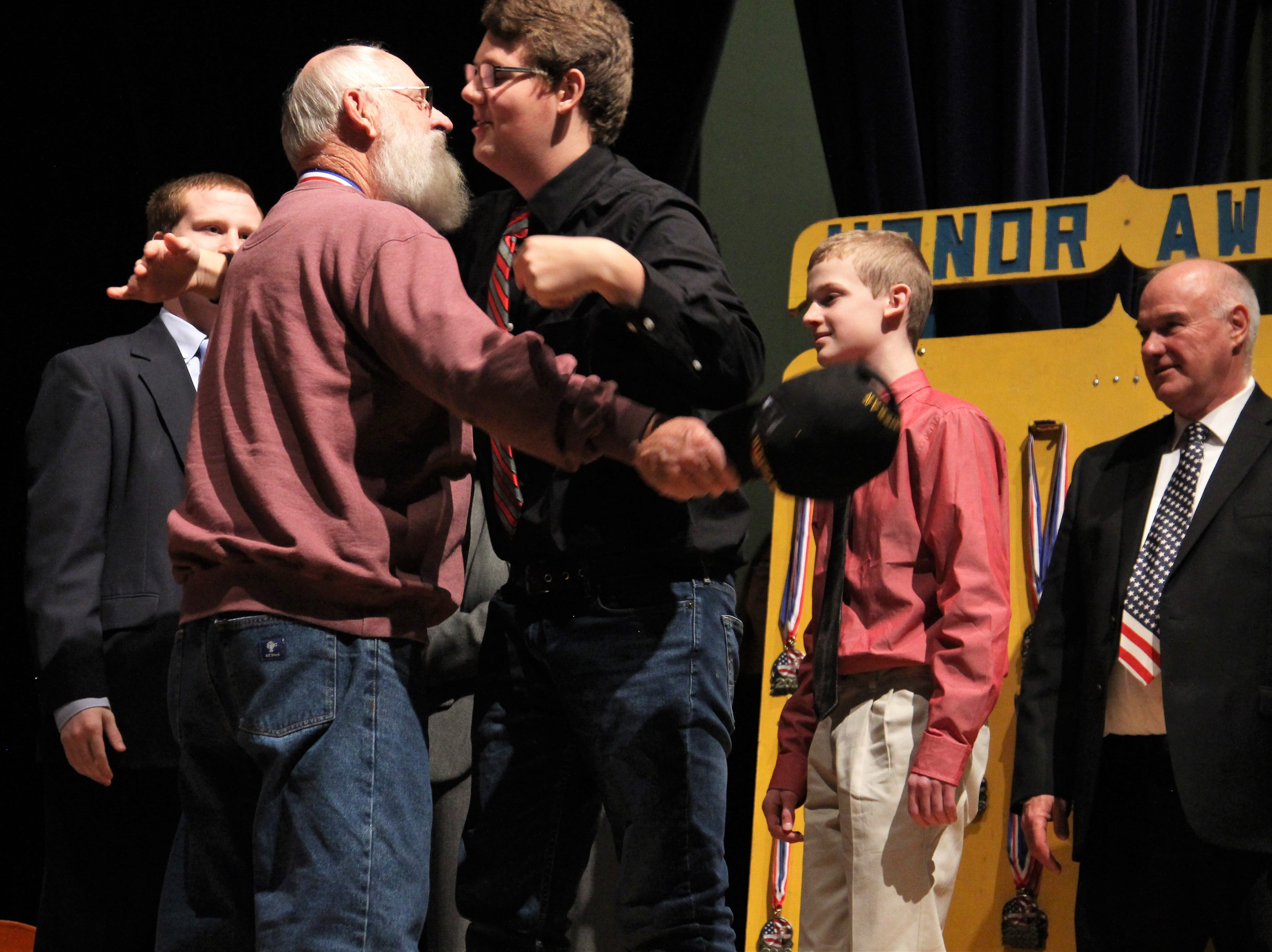 On Tuesday, a Veteran hugs a loved one as students at River Valley High School honored Marion County veterans with medals and speeches following Veterans Day.