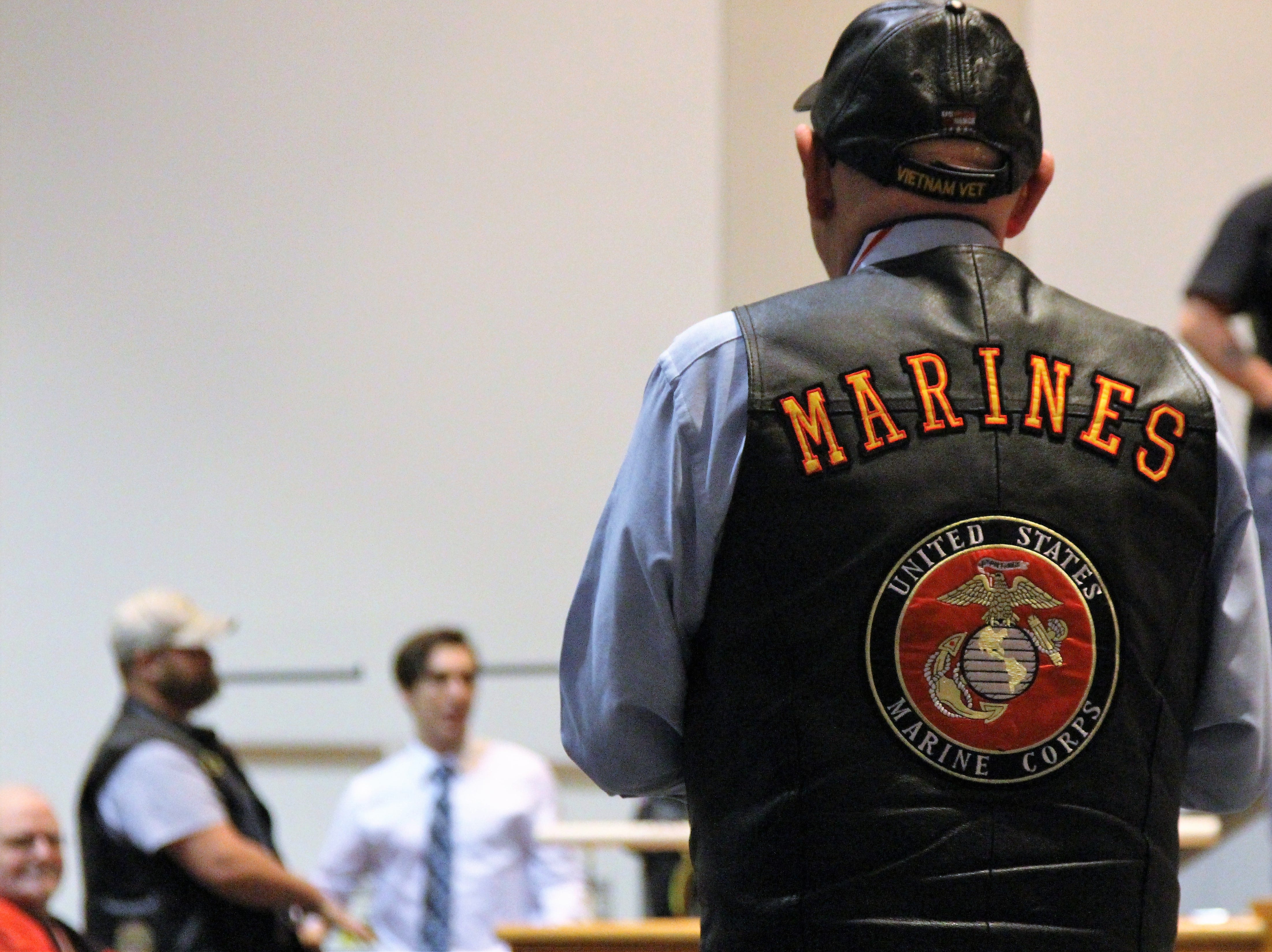 A Vietnam combat veteran walks back to his seat after receiving a medal during a post Veterans Day celebration at River Valley. He attended the ceremony with his son, a Marion who served in Iraq.