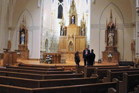 Congregants gathered at St. Mary Catholic Church on North Main Street Sunday evening. They were there to observe renovations on the old sanctuary of the church.