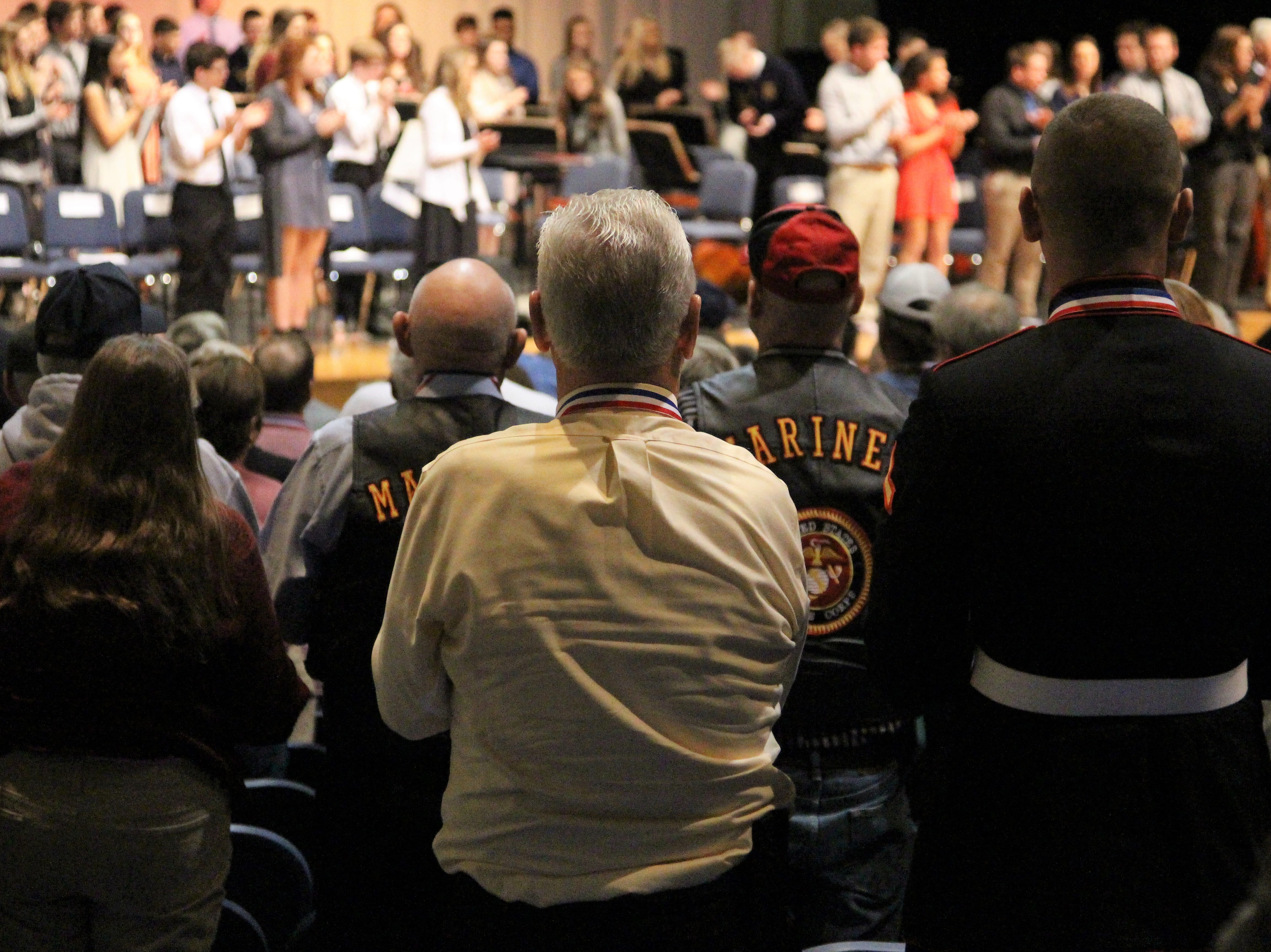 On Tuesday, veterans from different branches, different eras and different wars rose to their feet to honor a Marion resident who was killed while serving in Afghanistan. They had arrived at River Valley High School that morning to take part in a post Veteran Day celebration.