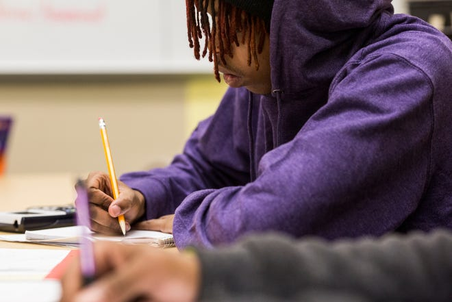 November 13, 2018 - Brennon Patterson takes notes while attending math class at school at Pathways in Education. Pathways to Education is a school in the Achievement School District.