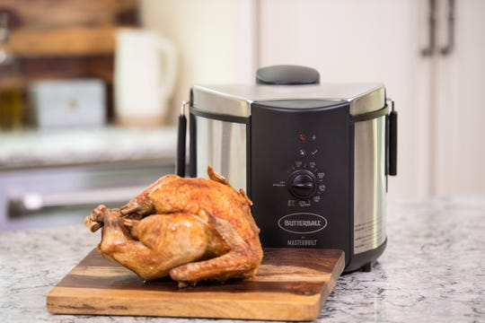 An electric turkey fryer is the safest way to fry a turkey, and you can cook it indoors.