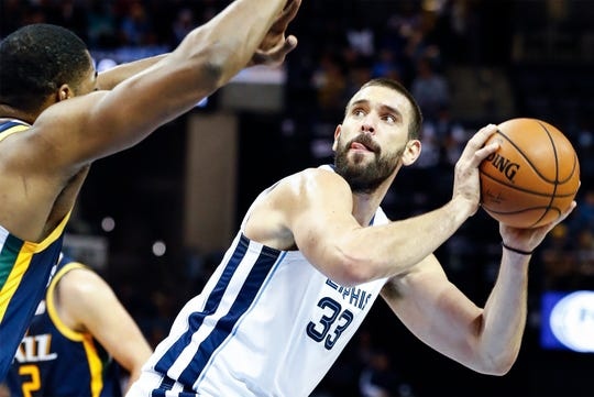Memphis Grizzlies center Marc Gasol (right) looks for a shot against the Utah Jazz defense during action at the FedExForum in Memphis, Tenn., Monday, November 12, 2018.