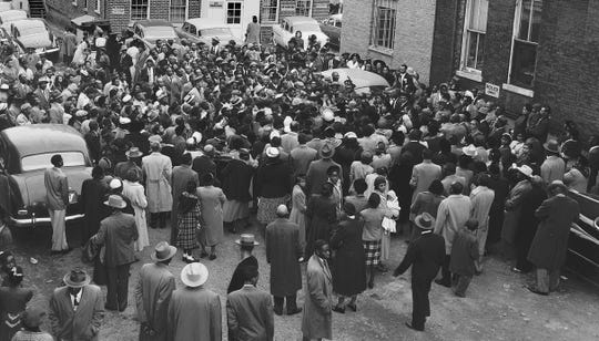"Chanting ""Yes, it's so!"" and shouting praises to the Lord, thousands of members of the Church of God in Christ gather outside Mason Temple in 1952. A few minutes earlier, C.H. Mason, the 87-year-old senior bishop addressed the Holy Convocation."