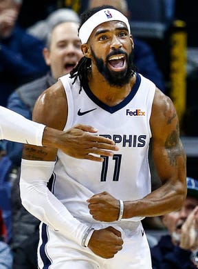 Memphis Grizzlies guard Mike Conley reacts after making a basket while being fouled by Utah Jazz during action at the FedExForum in Memphis, Tenn., Monday, November 12, 2018.