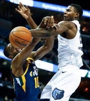 Memphis Grizzlies forward Jaren Jackson Jr. (right) blocks the shot of Utah Jazz guard Alec Burks (left) during action at the FedExForum in Memphis, Tenn., Monday, November 12, 2018.