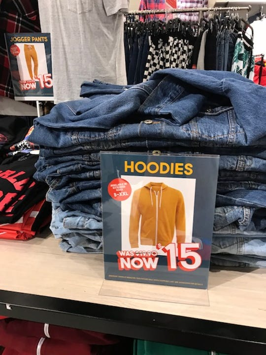 A store in Wolfchase Galleria proudly advertises hoodies for sale. But the mall claims that wearing the merchandise it sells violates dress policy - and had a young black man arrested for doing so.