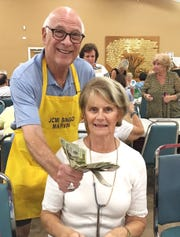 Andrea Bradley, pictured with Bingo Committee member Marvin Klein. Bradley was the big winner at Monday Night Bingo held every week at the Jewish Congregation of Marco Island.