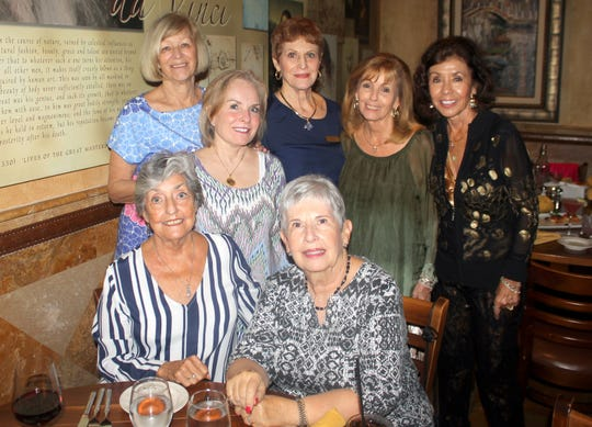 Ready to eat are seated: Jean Davis and Rosalie Tornello; standing: Betty Muskus, Becca Scarborough, Pam Clune, Sandi Friend and Marge Superits.