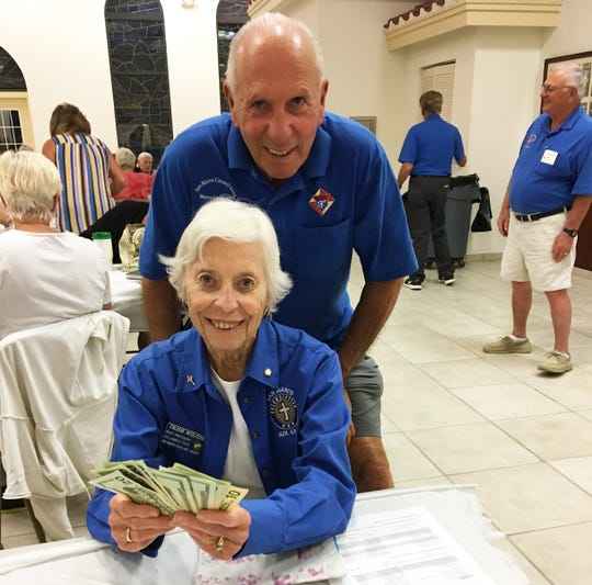 On Thursday, Nov. 8, the Knights of Columbus San Marco Council #6344 hosted a Bingo fundraiser in the San Marco Parish Center. Above, the big jackpot winner, Trish Wilcox.