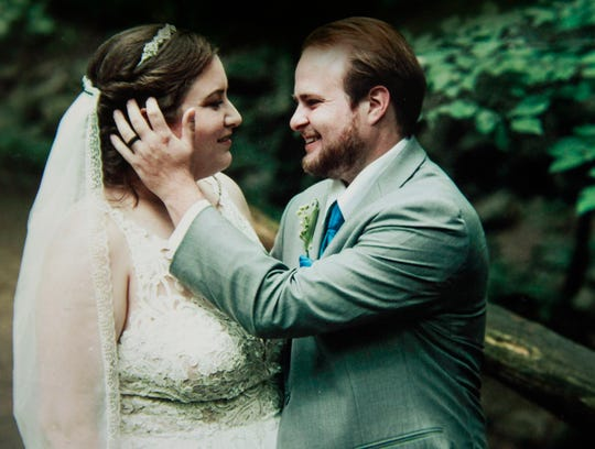 Bridget and Adam Spoerri on their wedding day. Adam contracted acute flaccid myelitis two weeks after their wedding.