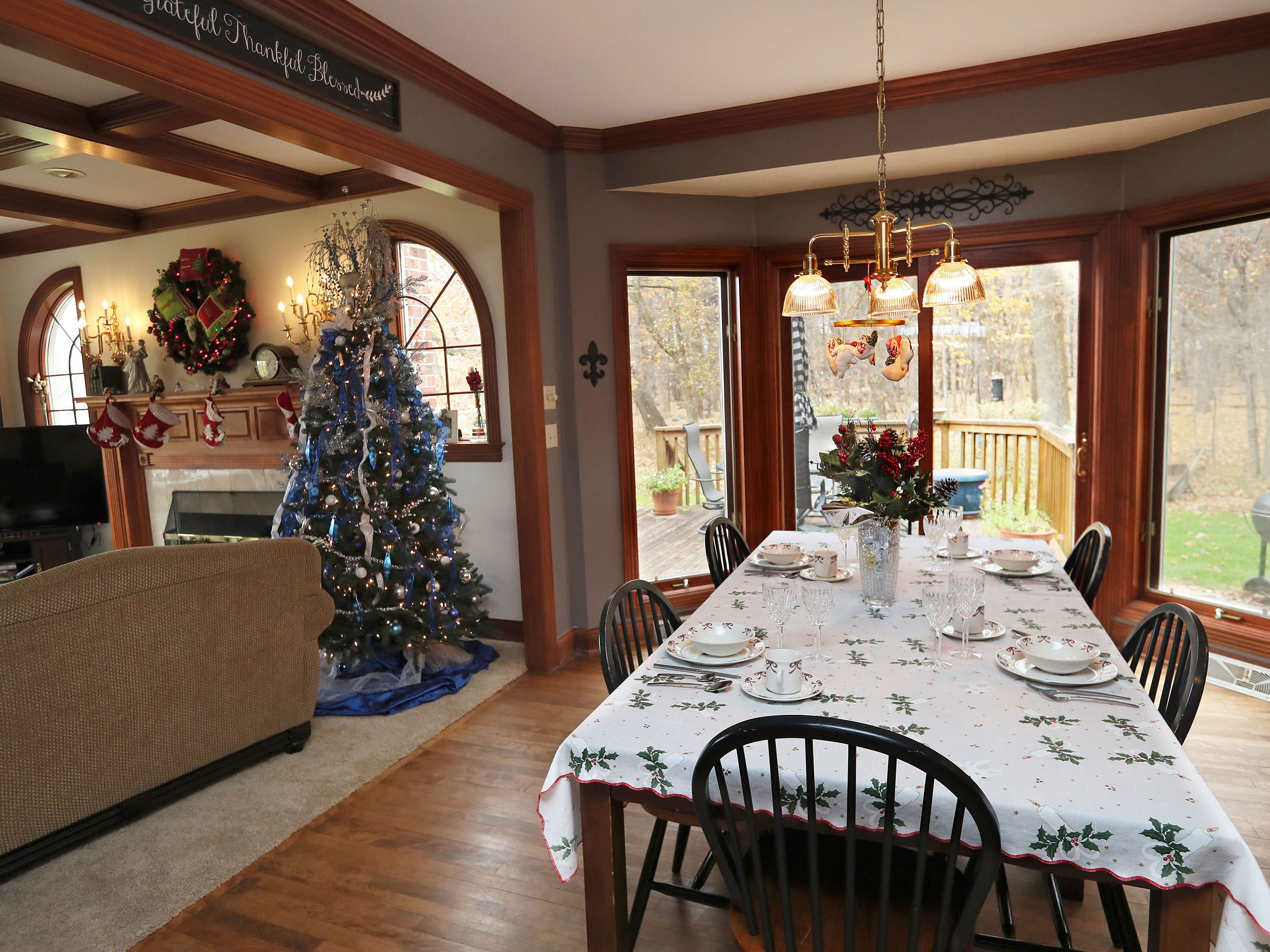 This informal dining area, set for Christmas, is between the family room and kitchen.