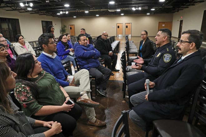 Milwaukee Police Chief Alphonso Morales (right rear) holds a joint town hall Monday with the Mexican Consulate's consul, Julian Adem (right foreground). They were joined by residents and discussed MPD's Standard Operating Procedure 130 Foreign Nationals, and Immigration Enforcement, and share their opinions and concerns.  It was held the Mexican Fiesta Headquarters, 2997 S. 20th St.