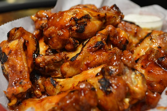 Fourth-N-Long's wings are made fresh. These are the bar's Thai chili wings.