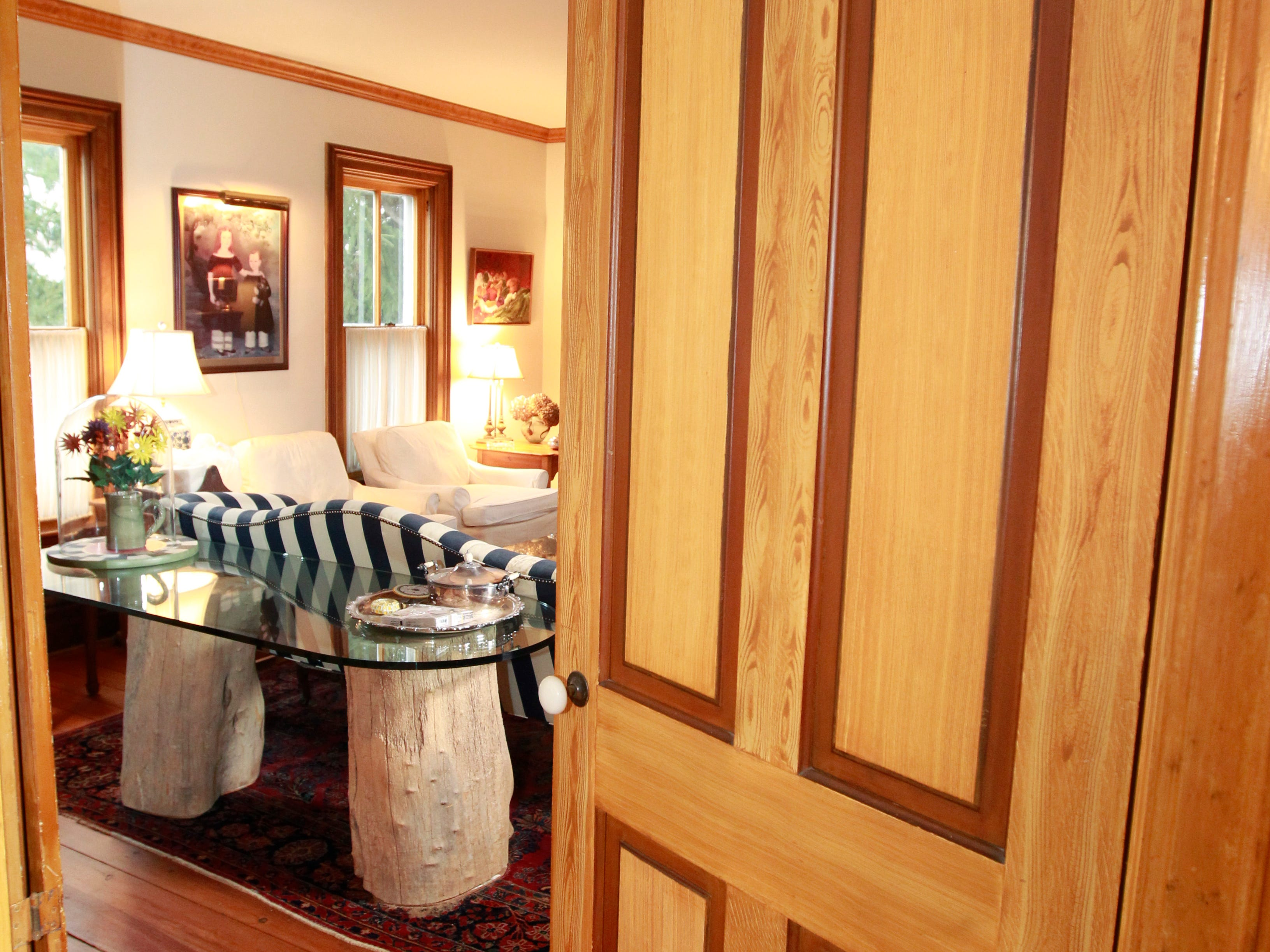 This door leading to the living room is original to this 1881 farmhouse owned by Betty and Lynn Adelman.