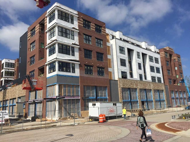 An office co-working operation will be coming to the street-level commercial space at Synergy Apartments, shown under construction this spring at Wauwatosa's Mayfair Collection mixed-use development.