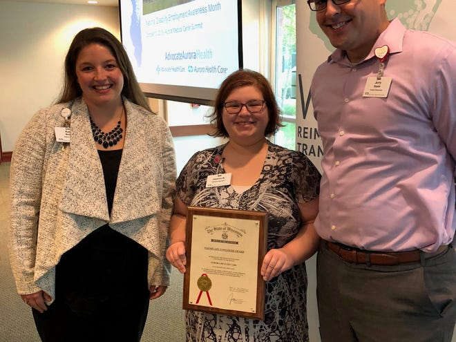Aurora Health Care was recently recognized by the Wisconsin Department of Workforce Development for the hospital's program of hiring people of diverse abilities. Pictured are Kara Mollet (left), Aurora manager of patient access, Jessica Bahr, an Aurora employee who came through the program and Jerry Baake, Aurora's human resources manager.