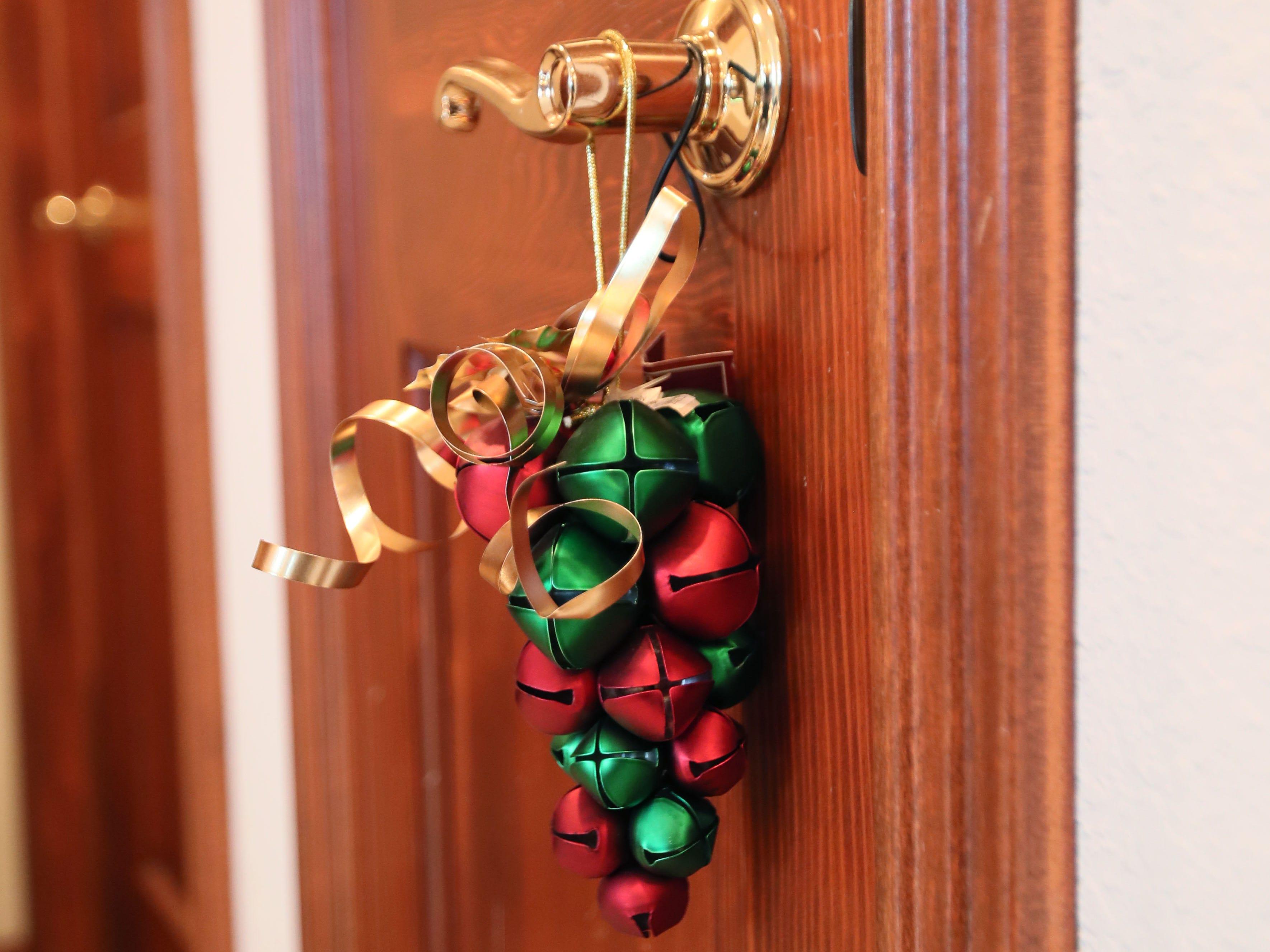 Jingle bells hang on a door handle on the second floor.