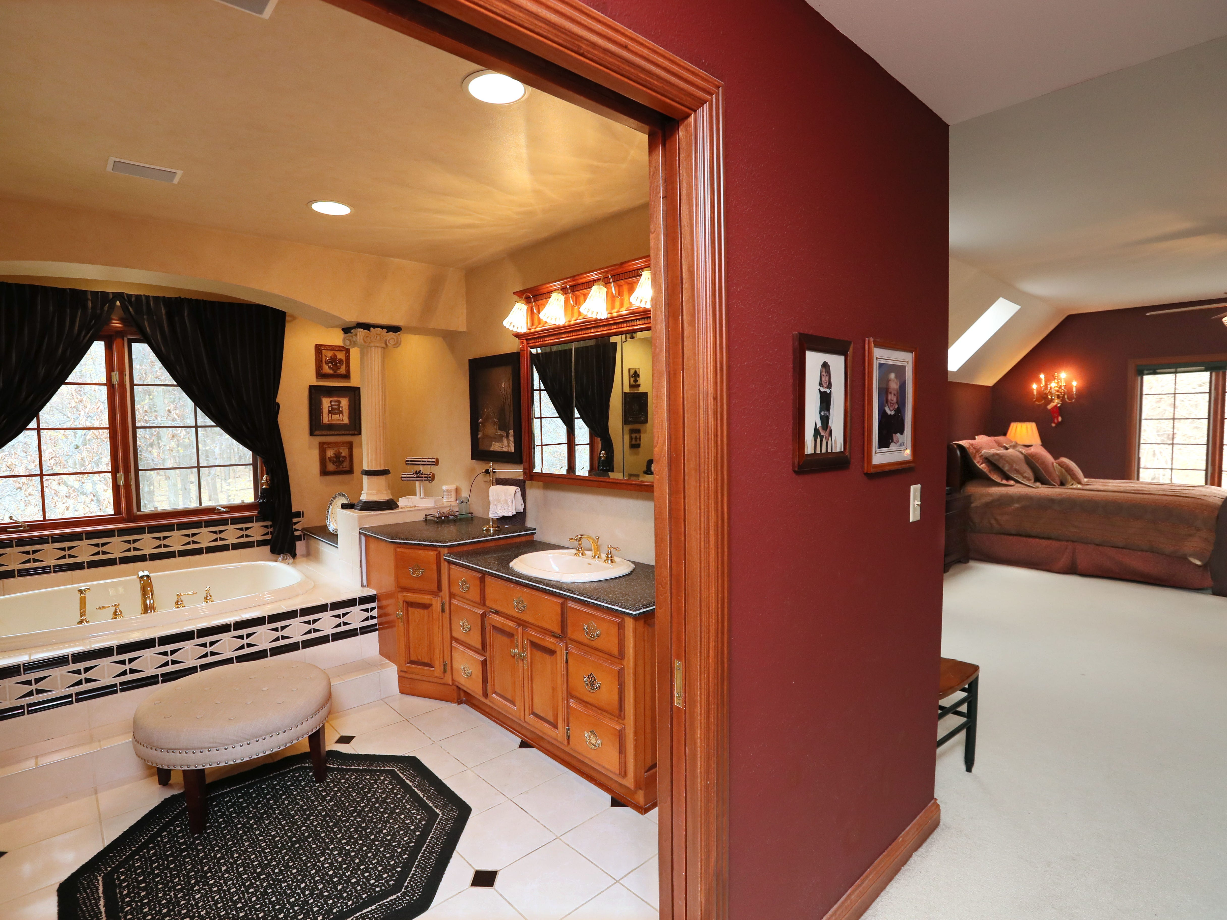The master suite takes up the entire space above the home's three-car garage.
