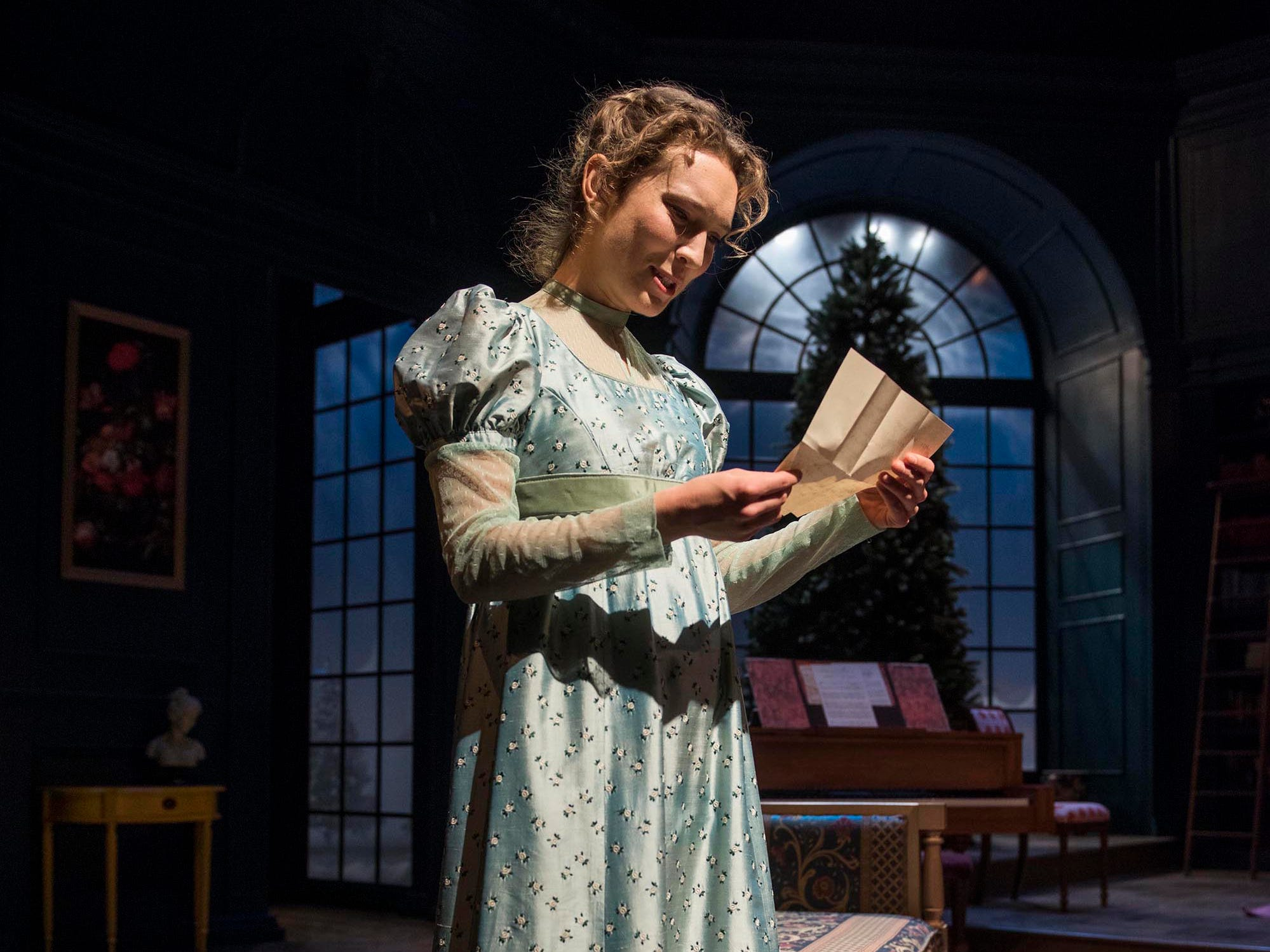 """Rebecca Hurd reads a letter in Milwaukee Repertory Theater's """"Miss Bennet: Christmas at Pemberley."""""""