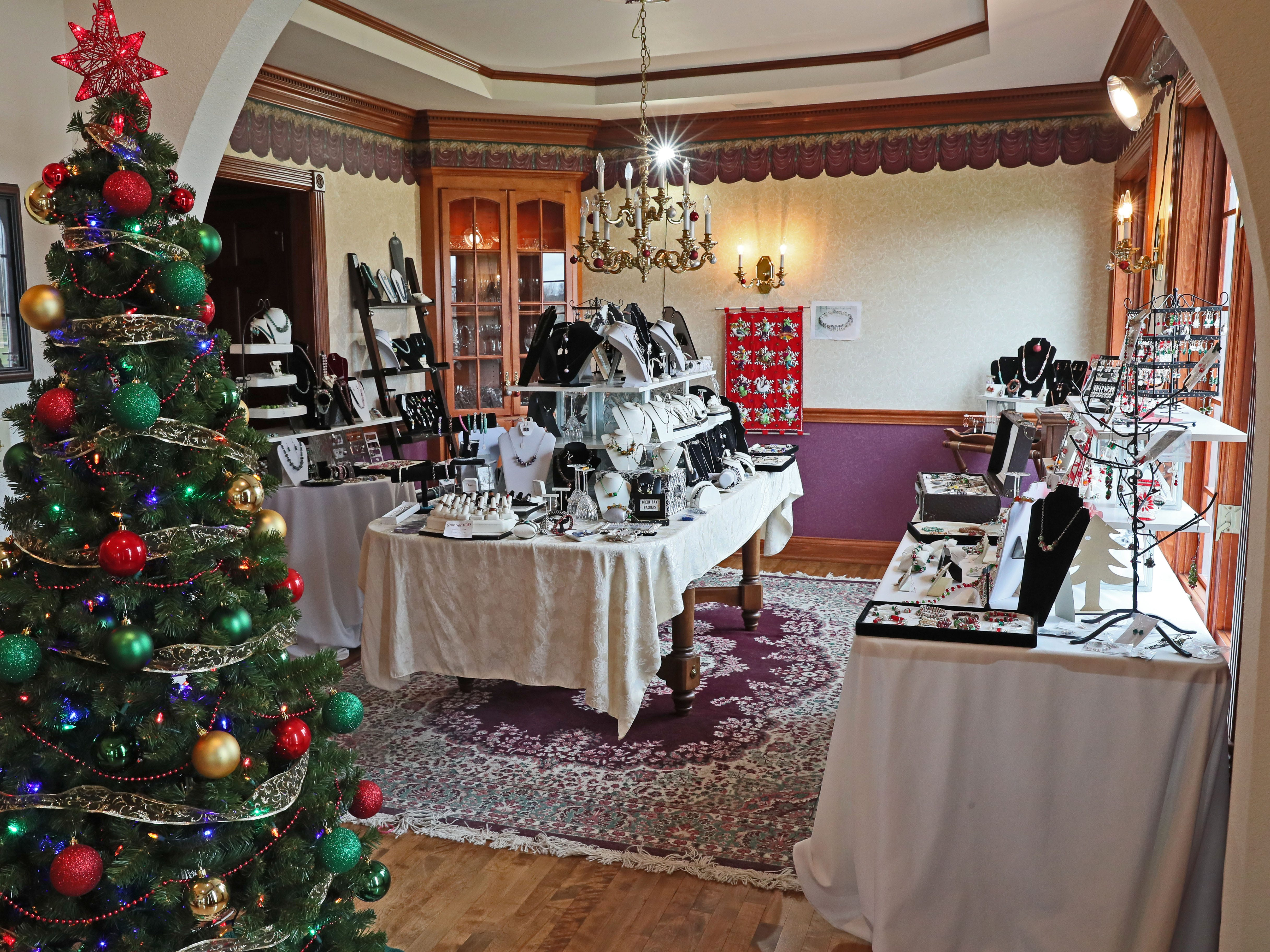 Janet Libbey uses this room to display the glass beads and jewelry she makes and sells.