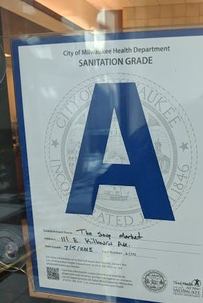 Restaurant grades, like this one posted at the Soup Market in the MIlwaukee Center downtown, could go by the wayside, if the state bars municipalities from issuing grades based on inspection reports.