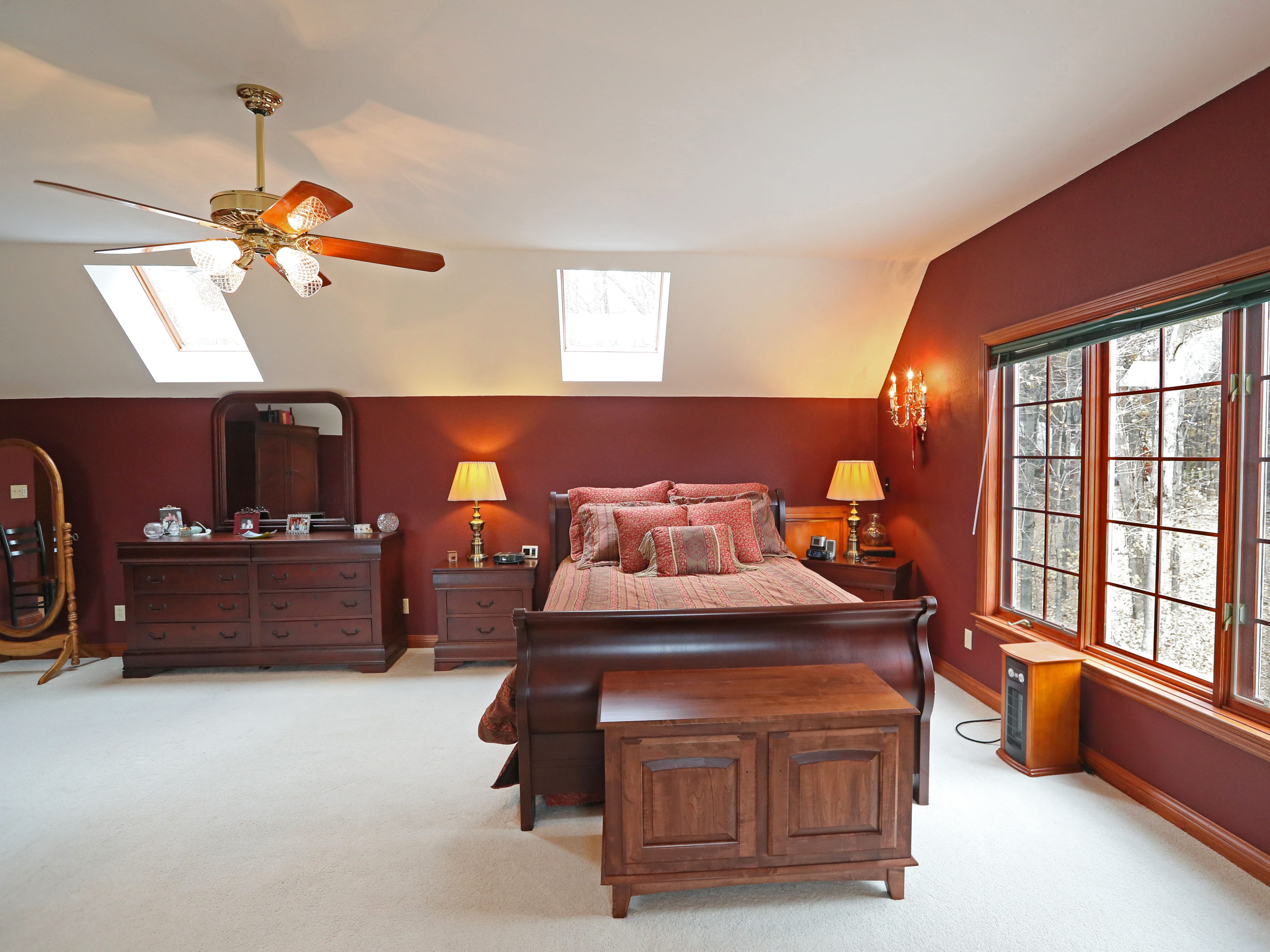 A number of rooms in the house, including the master bedroom, have neutral carpeting.