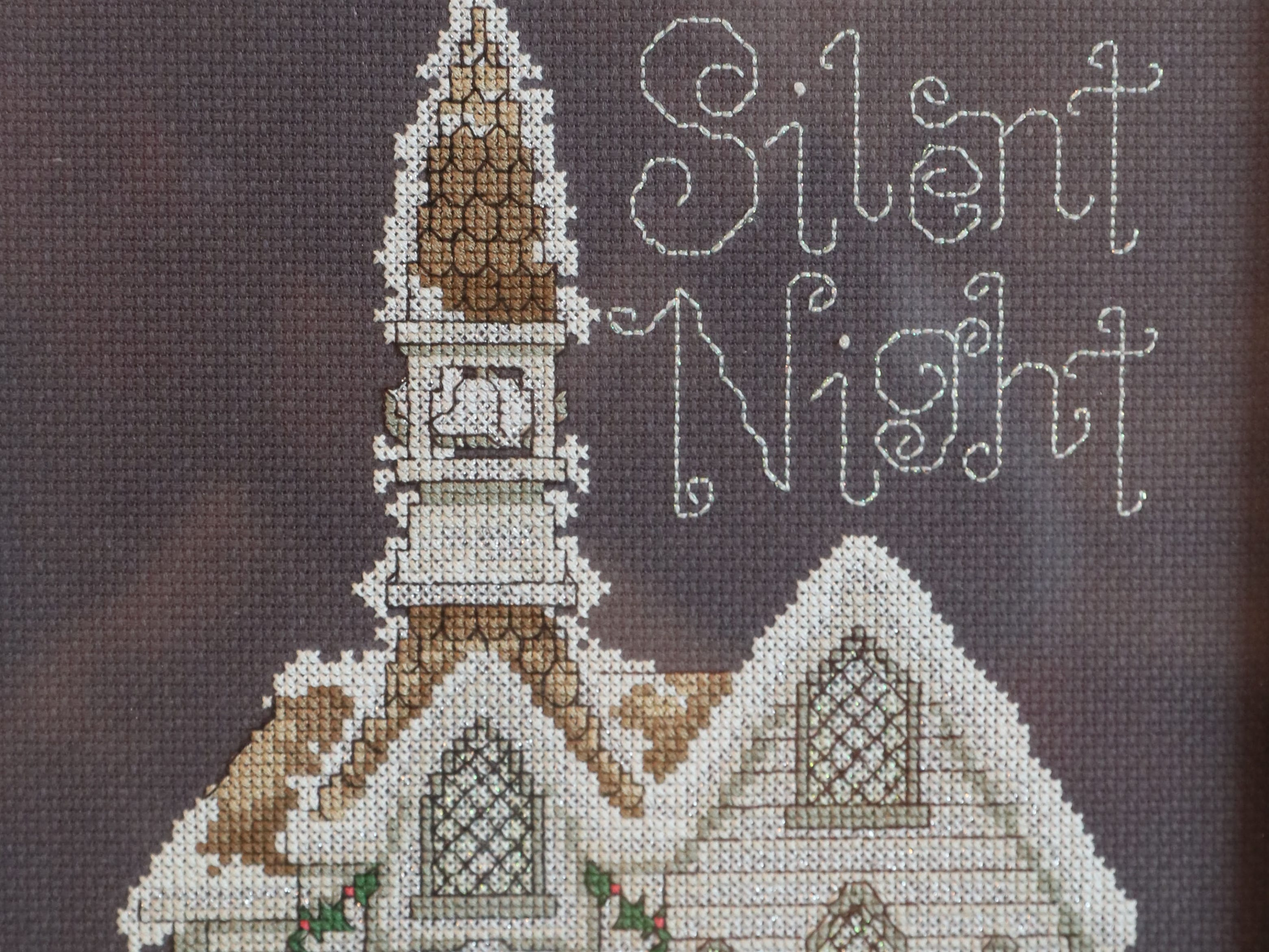 This cross-stitch picture done by Janet Libbey is one of her favorite holiday decorations.