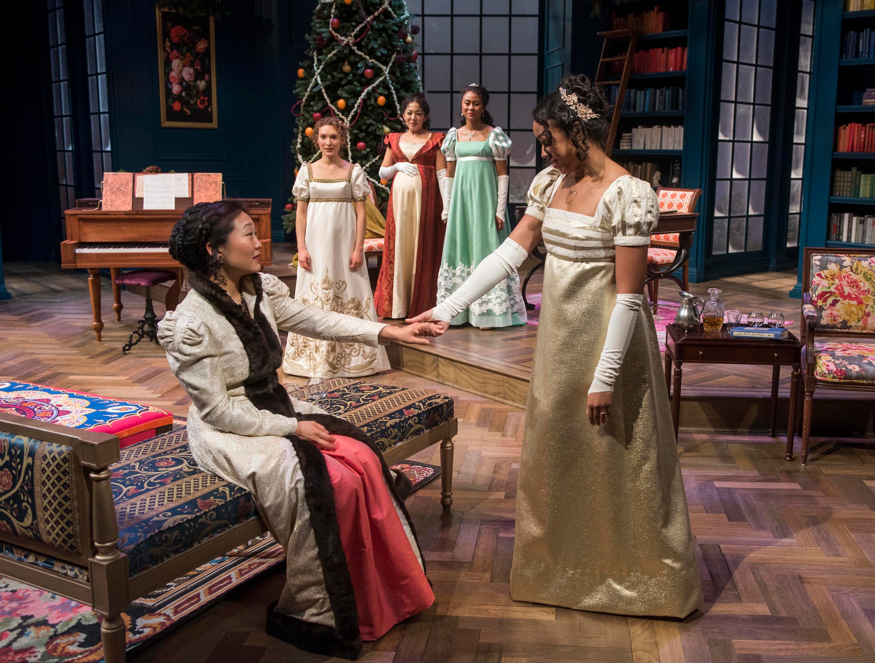 "Deanna Myers (seated) greets Margaret Ivey in Milwaukee Repertory Theater's ""Miss Bennet: Christmas at Pemberley."""
