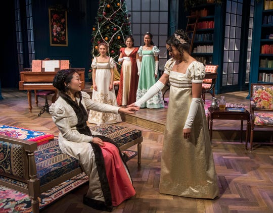 """Deanna Myers (seated) greets Margaret Ivey in Milwaukee Repertory Theater's """"Miss Bennet: Christmas at Pemberley."""""""