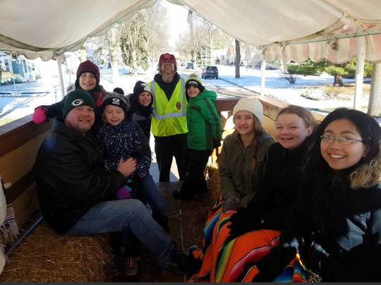 On this cold day, a few hardy and bundled up souls braved the winter-like weather to ride the wagon and collect donated food in the 2018 Rainbow Gardens Neighborhood Association food drive Nov. 10. Other volunteers opted to collect from nice warm cars.
