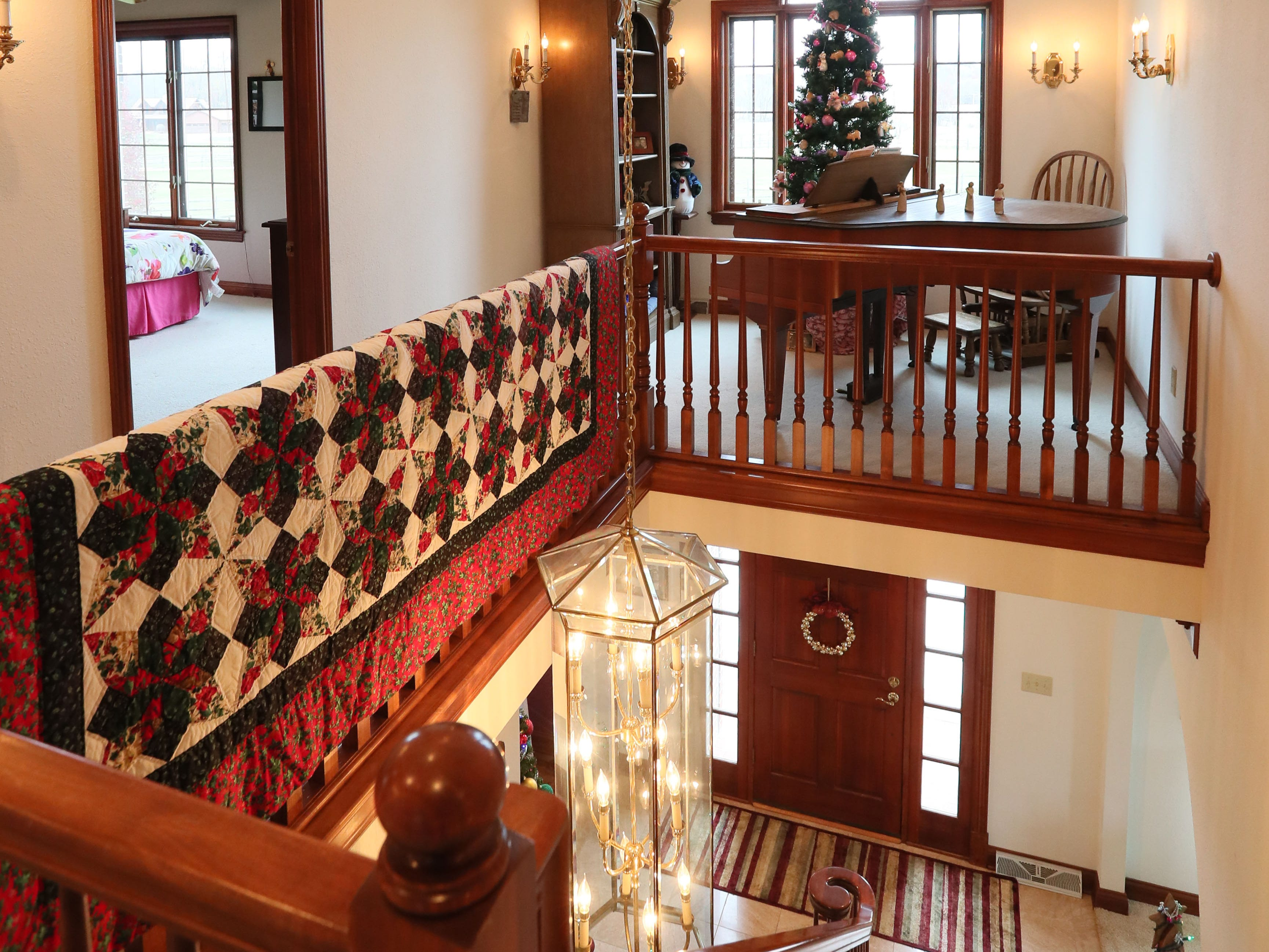 The quilt she hangs over the railing is one of Janet Libbey's favorite holiday accent pieces.