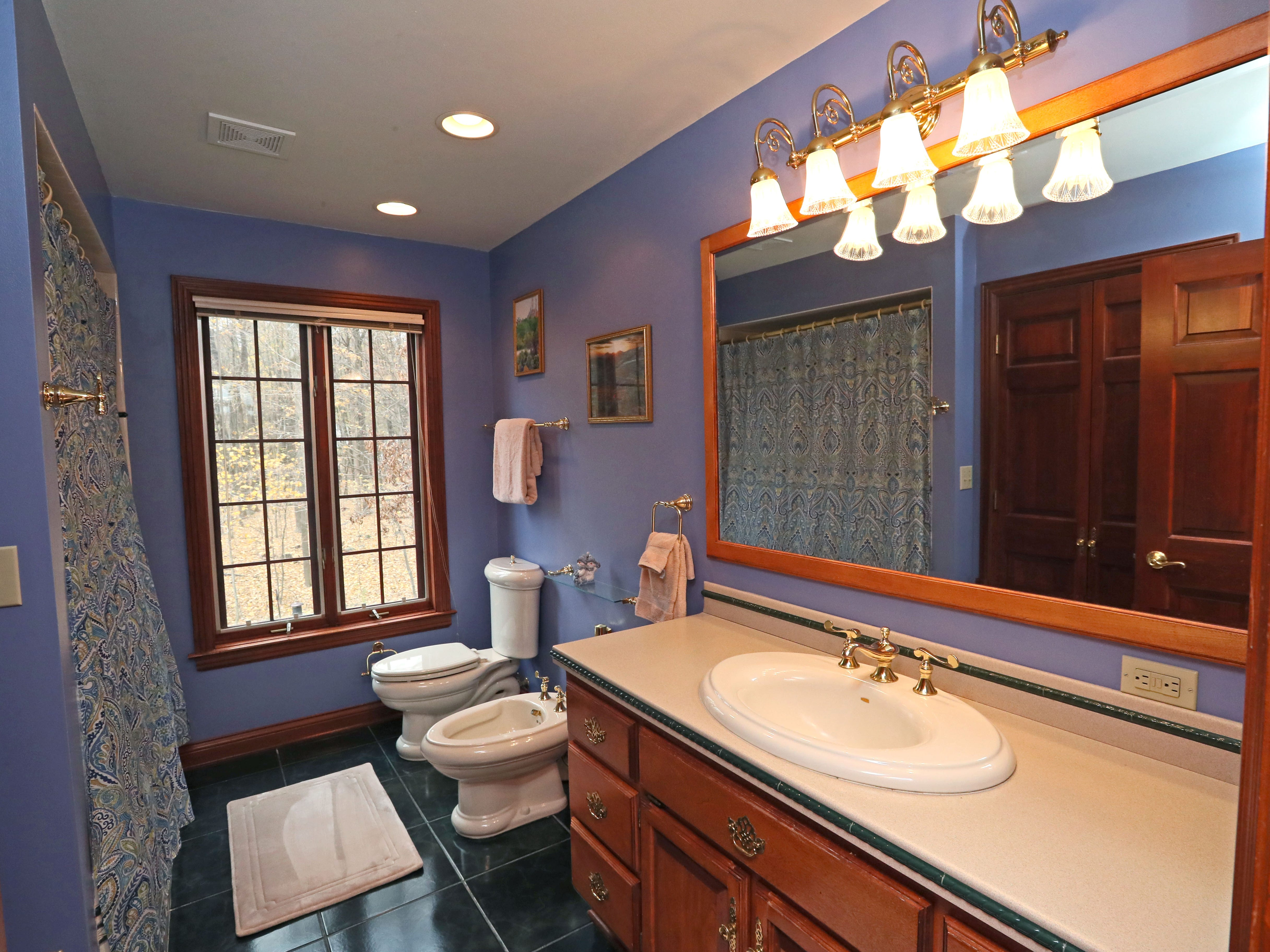 Some rooms, including the guest bathroom, have taken on fun colors recently.