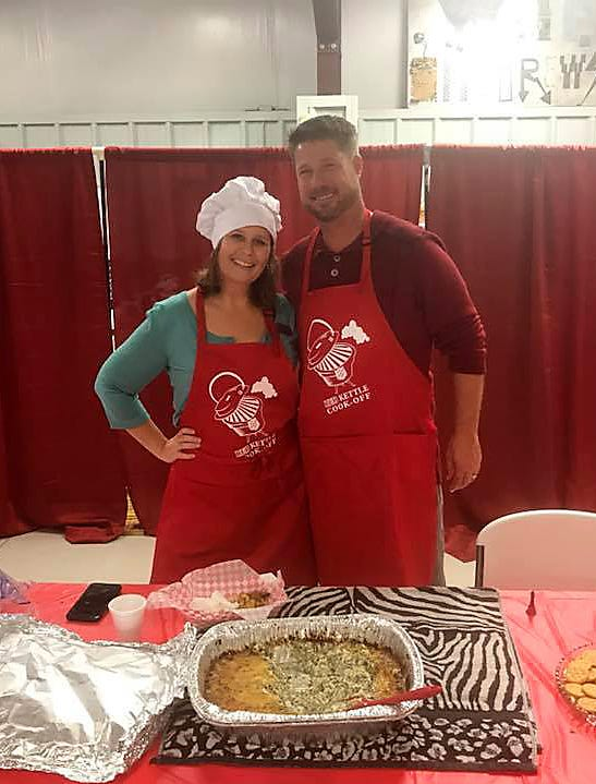 Angela Broome (left) and Erric Totty of the Mountain Home Chamber of Commerce took part in the Red Kettle Cookoff fundraiser.