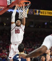 Arkansas' Daniel Gafford dunks against UC-Davis in this file photo. Gafford announced Monday that he will enter the NBA Draft and will not play in the Razorbacks' NIT games.