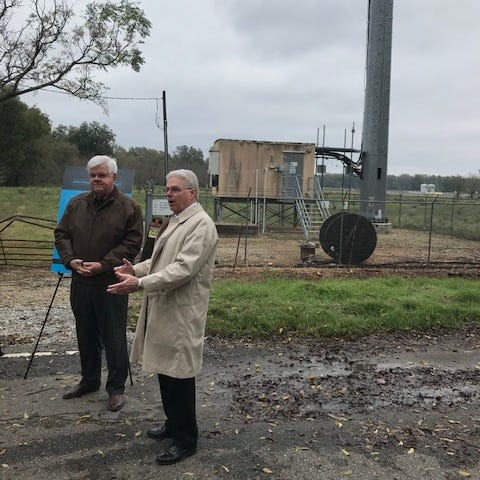 Public Service Commissioner Foster Campbell (left) listens as AT&T State Director Rick Demint describes the fixed-wireless broadband technology employed by AT&T at its new tower off U.S. 71 south of Bossier City.