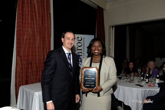 James Moore III with InterMountain Management presents Alberta Green the 27th Annual James M. Shipp Jr. Memorial Young Business Leader of the Year award.