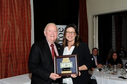 """Charles McDonald  presents Kelli Green, with Centric Federal Credit Union the Charlie Mac """"Twice as Much"""" Award. Green was selected by fellow classmates as the participant who displayed twice as much caring, giving and respect throughout the year."""