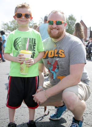 Trey Meador (7) and dad Michael at the Gallatin Main Street Festival on Saturday, October 6, 2018.