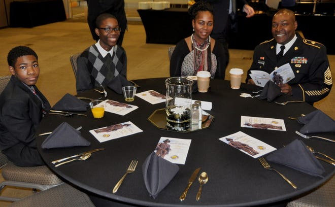 First Sgt. Terry Anderson, the Army reserve-component recipient of the 14th Annual Sergeant John Ordway Leadership Award, is joined by his wife, Arnethia, and children Tiyri (far left) and Tiyrai (second from left), before the start of the recognition breakfast at the Jackson Center in Huntsville on Nov. 8. Anderson is the first sergeant for Headquarters and Headquarters Company, 926th Engineer Brigade, Montgomery, Alabama.