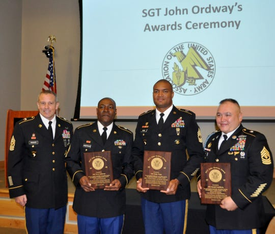 Command Sgt. Maj. Rodger Mansker, Army Materiel Command's senior enlisted advisor, congratulates the newest recipients of the Sergeant John Ordway Leadership Award during a recognition breakfast in Huntsville on Nov. 8. From left: 1st Sgt. Terry Anderson, Headquarters and Headquarters Company, 926th Engineer Brigade, Army Reserve Component; 1st Sgt. Teddy Wade, Headquarters and Headquarters, U.S. Army Aviation and Missile Command, Active Duty; and 1st Sgt. Joseph Lundberg, on an active-duty tour to the Pentagon, Army National Guard.
