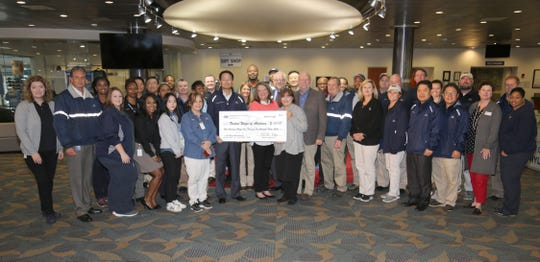 Hyundai Motor Manufacturing Alabama officials present a donation to the United Ways of Alabama.