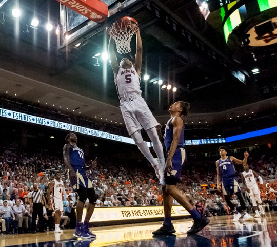 Auburn forward Chuma Okeke (5) dunks between Washington forwards Nahziah Carter (11) and Hamier Wright on Friday, Nov. 9, 2018, in Auburn, Ala.