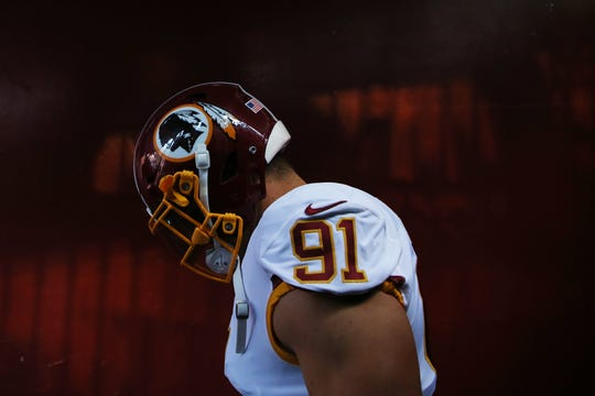 Oct 21, 2018; Landover, MD, USA; Washington Redskins linebacker Ryan Kerrigan (91) stands in the tunnel during player introductions prior to the Redskins' game against the Dallas Cowboys at FedEx Field. Mandatory Credit: Geoff Burke-USA TODAY Sports