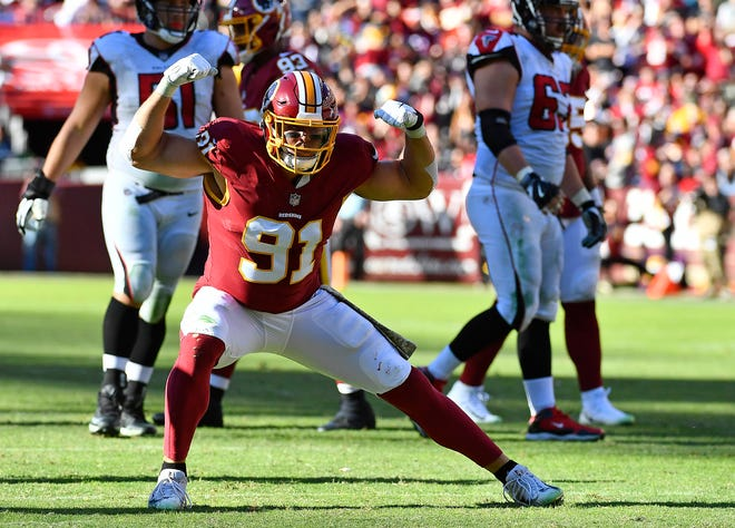 Nov 4, 2018; Landover, MD, USA; Washington Redskins outside linebacker Ryan Kerrigan (91) celebrates after a sack against the Atlanta Falcons during the first half at FedEx Field. Mandatory Credit: Brad Mills-USA TODAY Sports