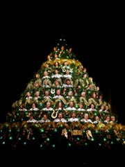 Grace Baptist Church and Heritage Hall choir members rehearse as the Living Christmas Tree in this file photo from 2012.