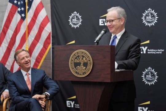 Nashville Mayor David Briley speaks at the Ernst & Young press conference as Gov. Bill Haslam looks on at Old Supreme Court Chamber in the Tennessee State Capitol Tuesday, Nov. 13, 2018, in Nashville, Tenn.